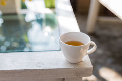 White cup pour hot green tea. My holiday with green tea Stock Images