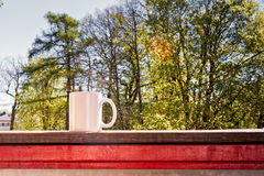 White Cup On A Rail Royalty Free Stock Photo