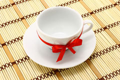 White cup with red bow Stock Images