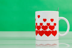 White cup with red hearts Stock Photo