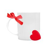White cup with red ribbon bow and heart on white background Stock Photos