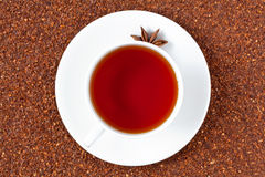 White cup of red rooibos South African tea with Royalty Free Stock Images