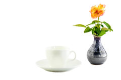 White cup and rose in a black vase Stock Photo
