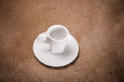 White cup on sacking Royalty Free Stock Image
