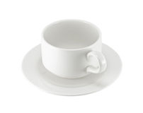 White cup on saucer. Isolated on white background Stock Photography