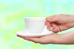 White cup with saucer on abstract background. Royalty Free Stock Photography