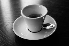 White cup on saucer black background,black and white. Stock Photo