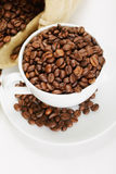 White cup and saucer with coffee crop Royalty Free Stock Photo
