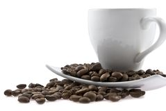 White cup with a saucer and coffee is spilled bob Royalty Free Stock Photography