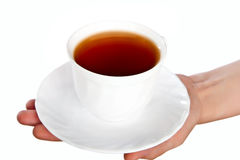 White cup with saucer in hand Stock Photos