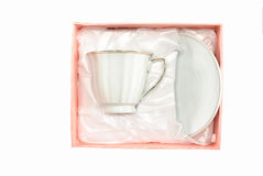 The white cup and saucer in pink box Royalty Free Stock Images