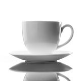 White cup and saucer on white Stock Image