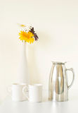 White cup set and flowers Royalty Free Stock Photos