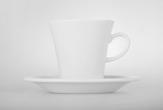White cup with seucer on white background Royalty Free Stock Photos