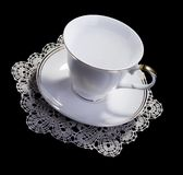 White cup on small doily Stock Images