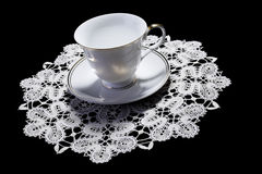 White cup on small doily Royalty Free Stock Image