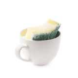 White cup with sponge inside Royalty Free Stock Photo