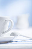 White cup and spoon Stock Images