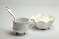 White cup, spoon and milk powder Royalty Free Stock Photography