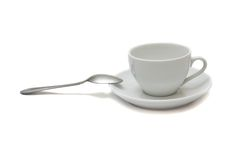 White cup with spoon and saucer Stock Images