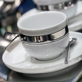 White cup and spoon set Royalty Free Stock Image