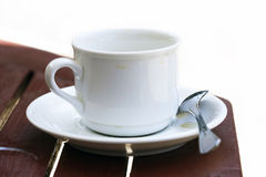White cup and spoon Royalty Free Stock Photography