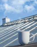 White cup stands on balcony railing Stock Images