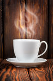 White cup with steaming hot drink Royalty Free Stock Image