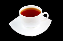 White cup of strong tea Stock Photos
