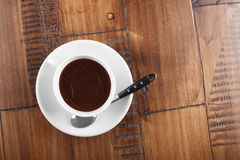 White cup of sweet chocolate. On brown wood table Royalty Free Stock Images