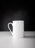 A white cup is on the table Stock Image