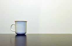 White cup on the table Royalty Free Stock Image