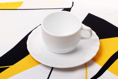 White cup on the tablecloth Stock Photography