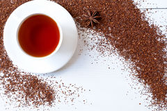 White cup of tasty traditional organic red rooibos Stock Images