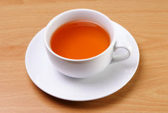 White cup of tea. Served on a table Stock Photos