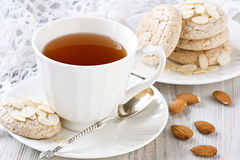 White cup tea and almond cookies Stock Photography