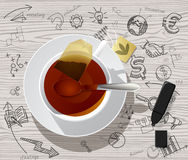 White cup with tea bag and hand drawn business icons. White cup with tea bag inside against a wood textured table and hand drawn business icons. There is in royalty free illustration
