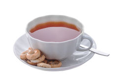 White cup of tea and bagels. White cup of tea, bagels and a spoon on the saucer Stock Image