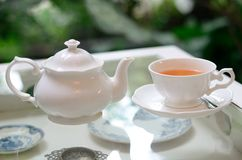 A white cup of tea on classic table. It's look clean and luxury Royalty Free Stock Images