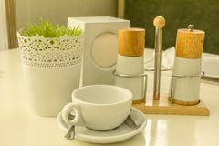 White cup for tea. White tea cup and cutlery are on the table Stock Photography