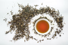 White cup of tea with dried tea leaf on the white background Royalty Free Stock Images