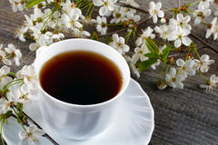 White cup of tea with flowers Royalty Free Stock Image