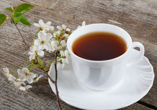 White cup of tea with flowers Royalty Free Stock Images