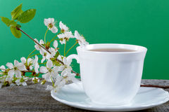 White cup of tea with flowers Royalty Free Stock Photo