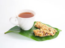 White cup of tea and healthy granola Royalty Free Stock Images