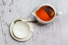 White cup of tea with kettle, top view point Stock Images