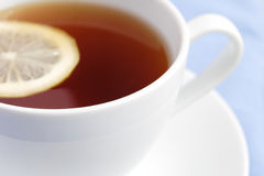 White cup of tea with lemon Royalty Free Stock Photo