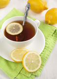 White cup of tea with lemon Royalty Free Stock Image