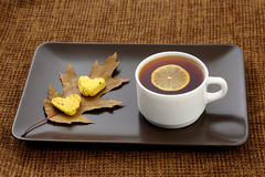White cup of tea with lemon on a saucer with cookies Royalty Free Stock Photos