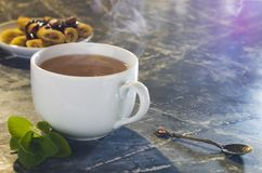 White cup with tea, pancakes with jam. Mint leaves. Tea mood royalty free stock photos